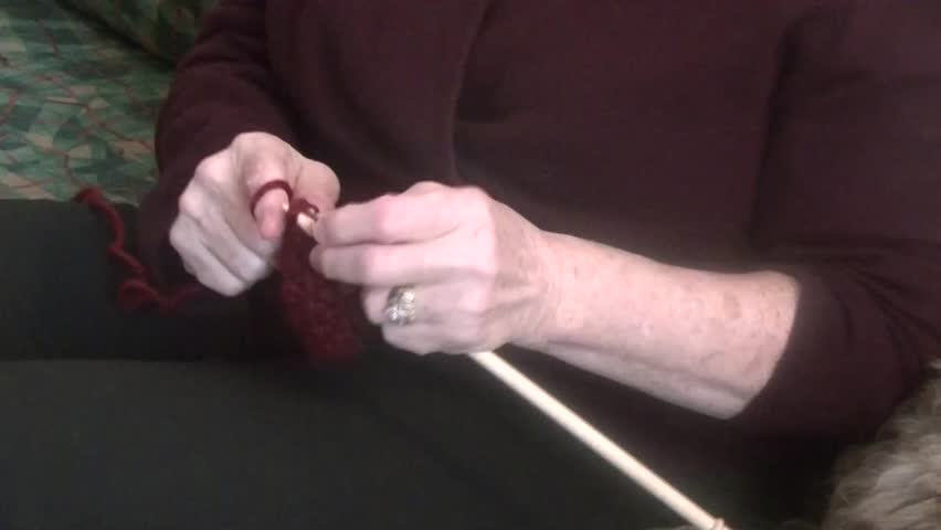 Women Knitting a wool Scarf