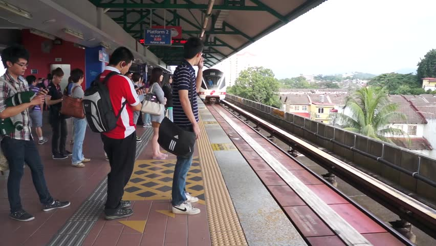 KUALA LUMPUR - DEC 22: Passenger a waiting train at station Wangsamaju Kuala Lumpur, on Dec 22, 2012.