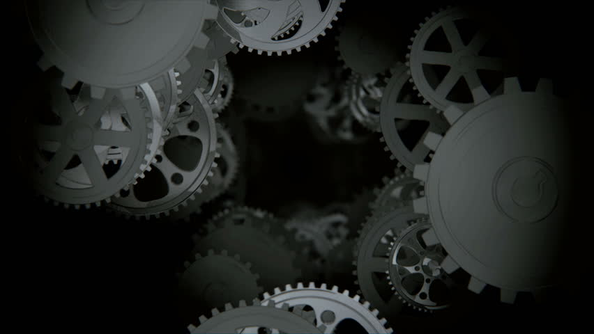Camera moving through spinning gears and cogs