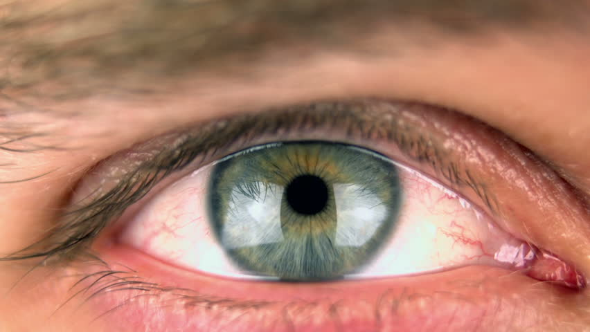 Super 35mm camera - Closeup of an blue/green eye - HD stock video clip
