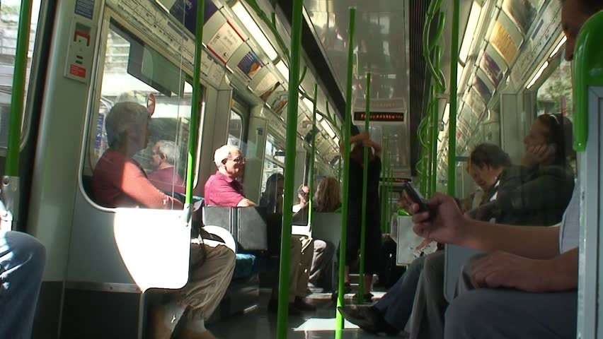 LONDON, ENGLAND - CIRCA 2007: Inside an underground subway on the tube in London - HD stock footage clip