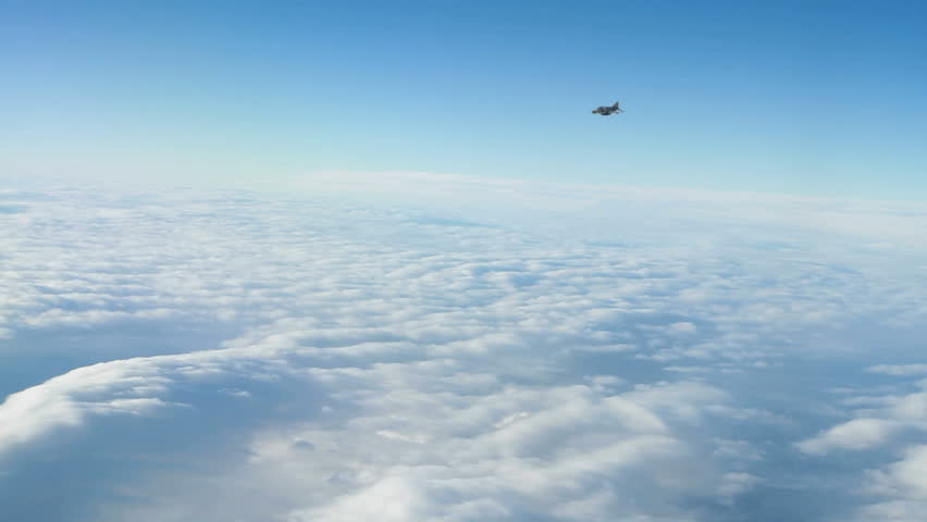 A Turkish F-4E Phantom fighter Jet banking and flying towards the camera. - HD stock footage clip