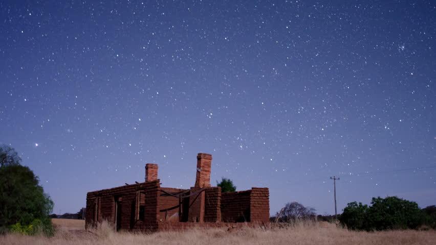 Star time lapse (astro timelapse) over the ruins of a more than one hundred year old house on an Australian farm. Shadows creep in as the moon sets and sky goes dark.