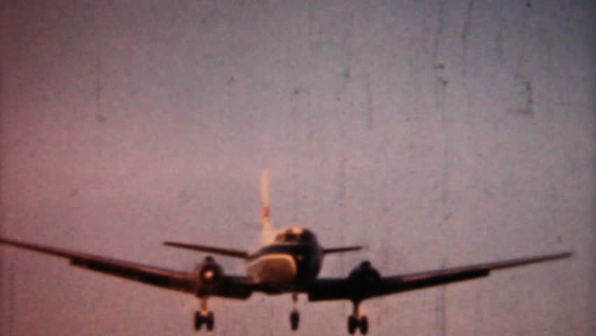 A shot of an airplane coming in for a landing in 1958 in Pennsylvania. 1958 Vintage 8mm film