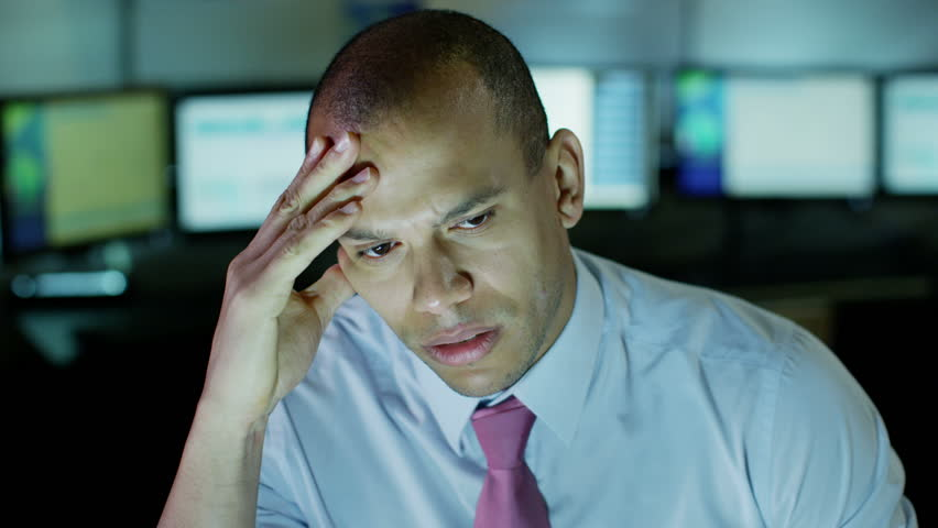 Tired and stressed businessman is working late into the night - HD stock video clip
