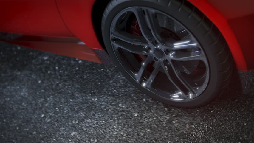 Alloy wheel of red sports car, driving on the road. Clip is loop-ready. - HD stock video clip
