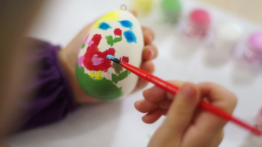 Learning to Draw. Child decorates Easter egg - HD stock footage clip