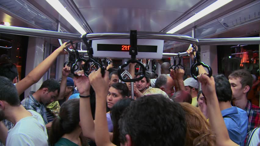 ISTANBUL, TURKEY 2012 A crowded subway or tram with passengers holding handles.