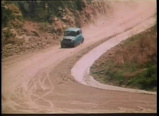 1970s car driving on dirt road - SD stock video clip