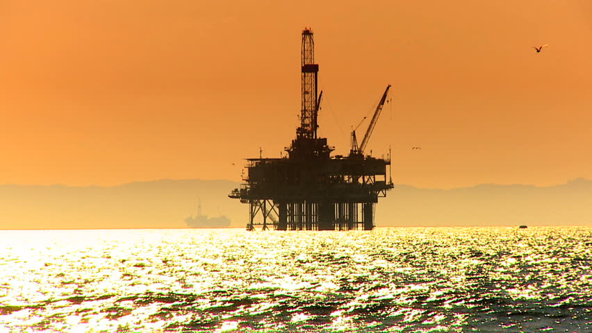 Oil platform in the sea at sunset - HD stock footage clip