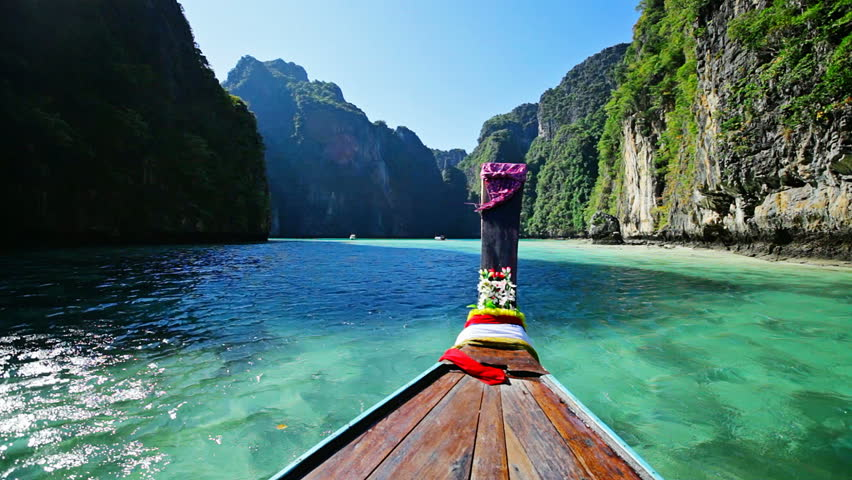 1920x1080 hidef, hdv - Moving on thai traditional wooden boat among the tropical islands