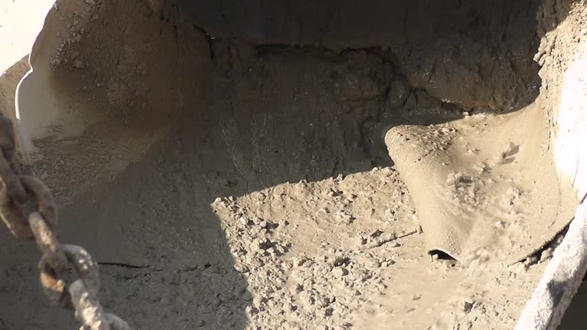 View of freshly mixed concrete in a mixer for use on a construction site will be ditributed