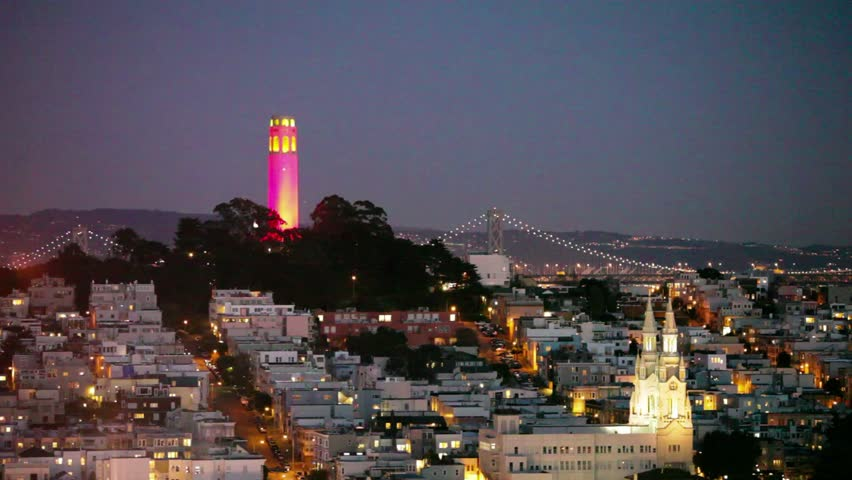 SAN FRANCISCO - JAN 13: View of Coit Tower and St. Peter and Paul church at night in San Francisco on January 13, 2013. Coit tower is lit red and gold in honor of the SF 49ers making the NFL playoffs.