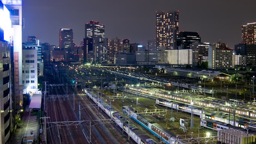Tokyo trainyard and skyline timelapse