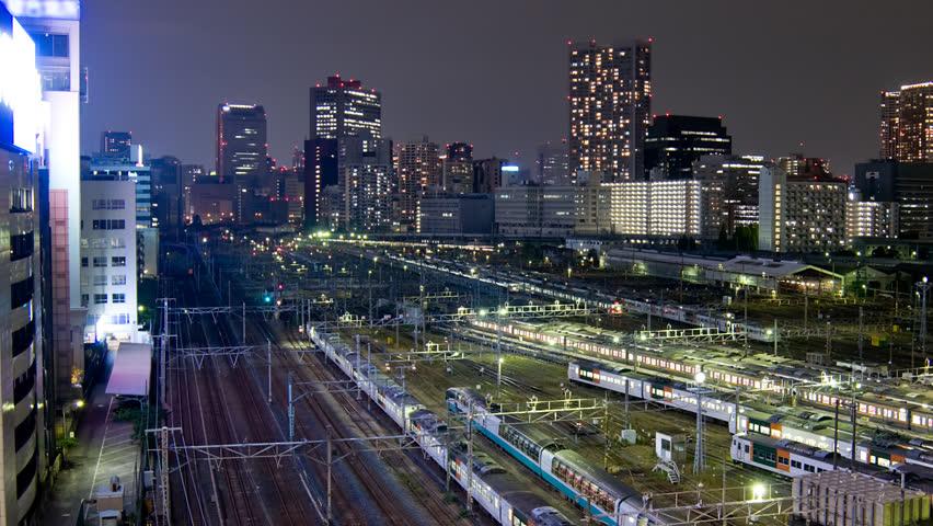 Tokyo trainyard and skyline timelapse