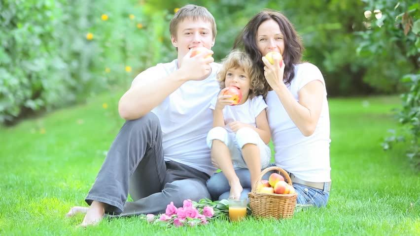 Happy family having picnic in spring park - HD stock video clip