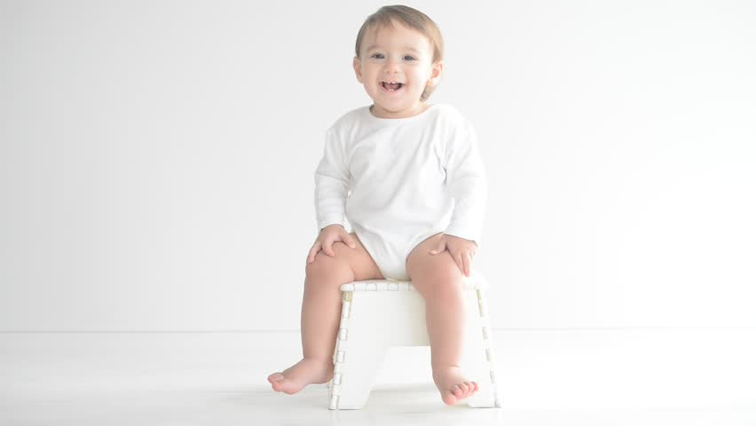 Adorable baby having fun and playing