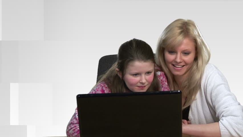 Mother helping a child on a Computer - HD stock footage clip