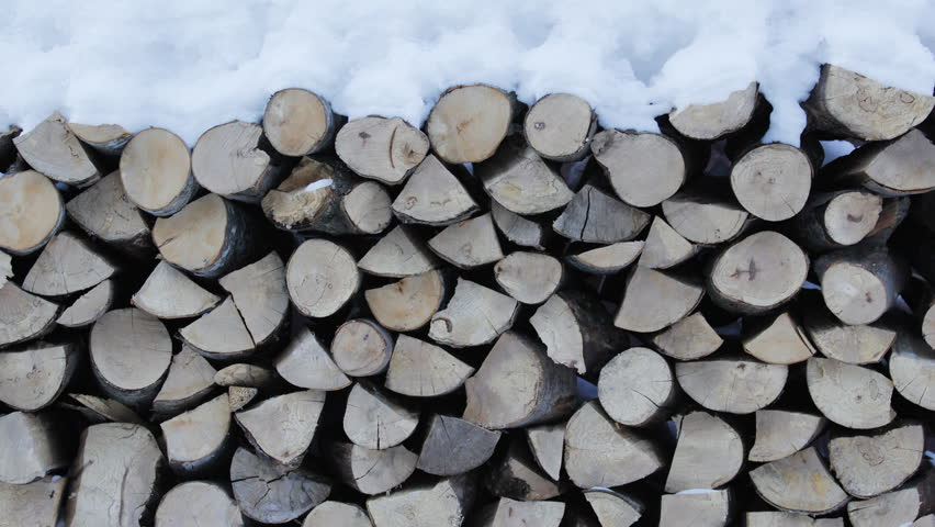 Winter pile of cut wood fire stock