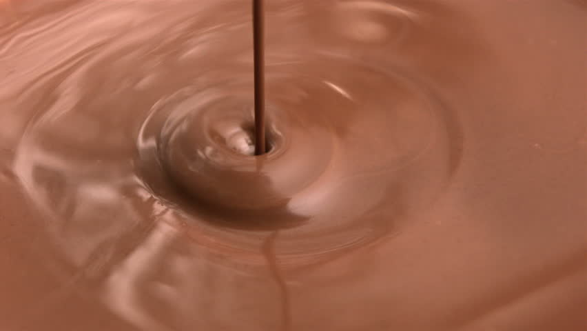 Melted chocolate being poured in slow motion