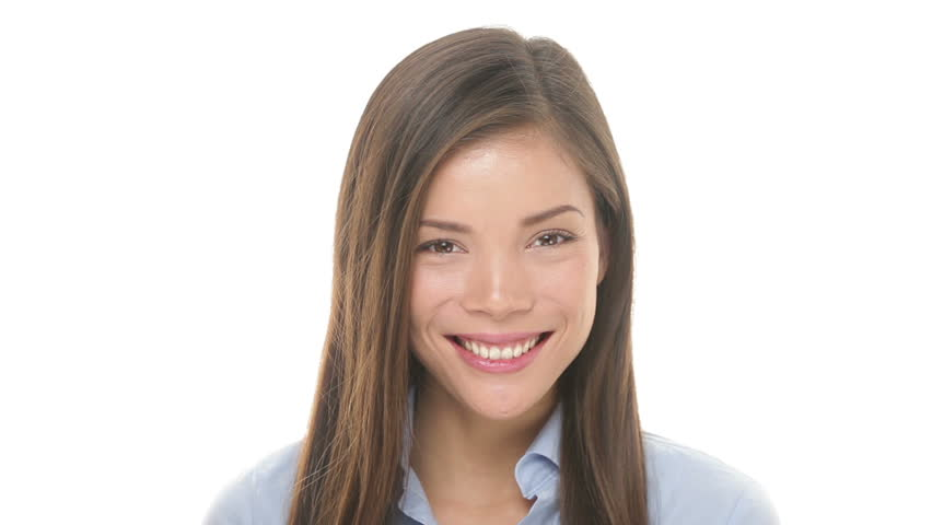 Woman smiling closeup portrait. Young business woman professional looking at camera happy. Beautiful multiethnic Asian / Caucasian female model on white background in studio. - HD stock footage clip
