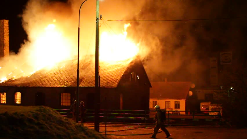 A house made of bricks is burning down