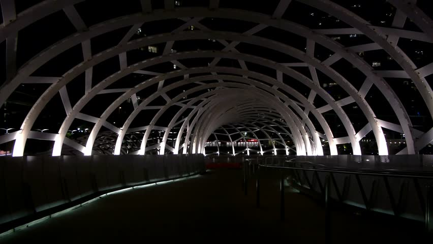MELBOURNE, DOCKLANDS - FEBRUARY 19 2013: Web Bridge at night in Melbourne, Australia.