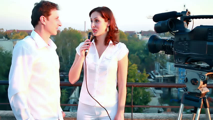 A young journalist has television interview with famous guests, Interview, video clip
