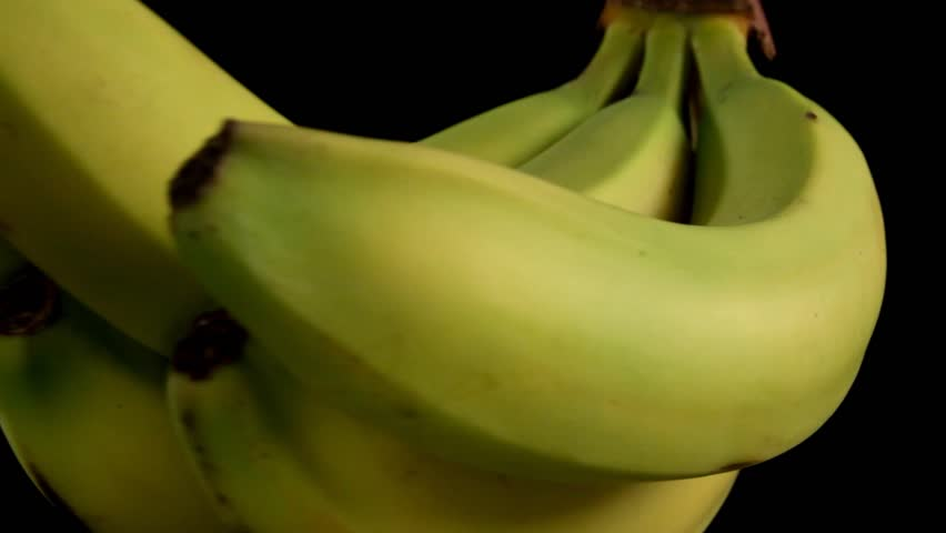 Bunch of Bananas rotating on black background - Looping Closeup - HD stock footage clip