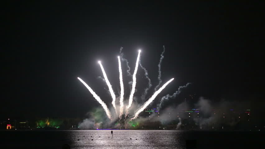 Fireworks against the dark sky background. - HD stock video clip