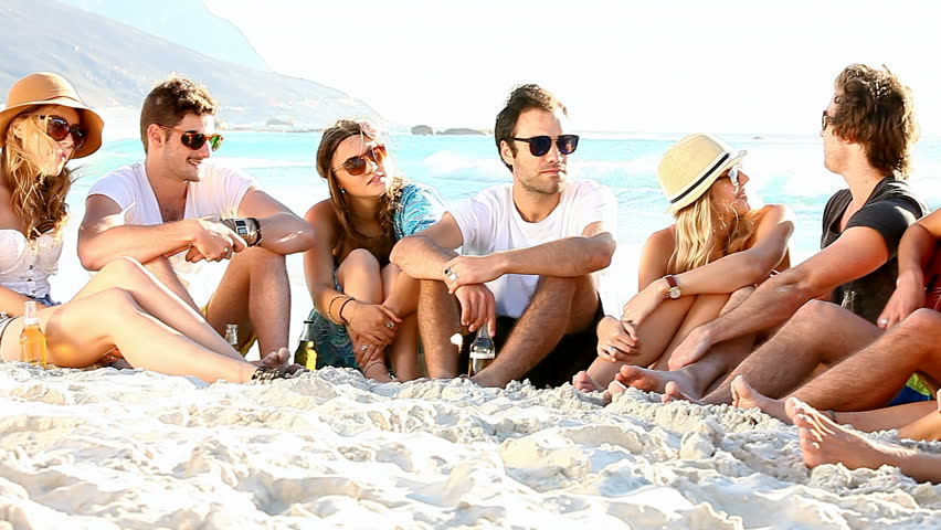Young hipster people enjoying a beach party with guitar music - HD stock footage clip