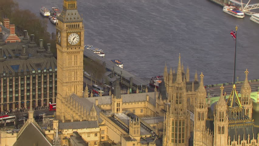 Aerial shot of the famous landmark Big Ben and Houses of Parliament in London's city of Westminster, situated by the side of the river Thames.