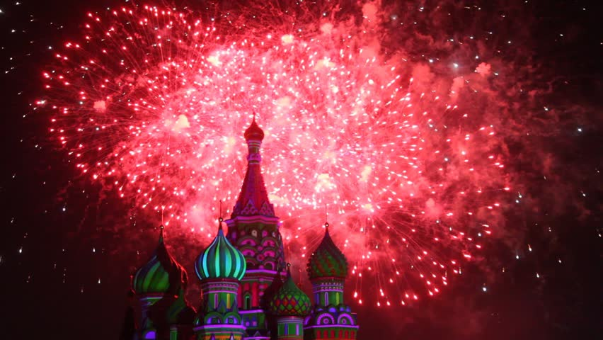 MOSCOW - AUG 31: Top of Saint Basil Church and sky illuminated by fireworks at Military Music Festival Spasskaya Tower, on Aug 31, 2011 in Moscow, Russia.