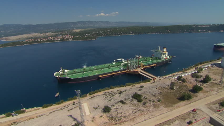 Aerial shot of two tanker boats anchored in LNG terminal - HD stock footage clip