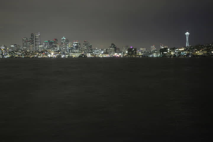 View overlooking Lake Union of the downtown Seattle skyline with Space Needle at night. Shot as 4K (4096x2730) time lapse from Gasworks Park in Spring of 2011.