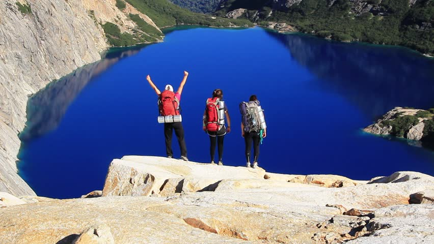 successful girls standing over cliff after trekking - HD stock footage clip