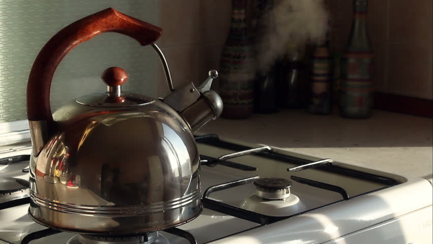 Simmering whistling kettle on the stove
