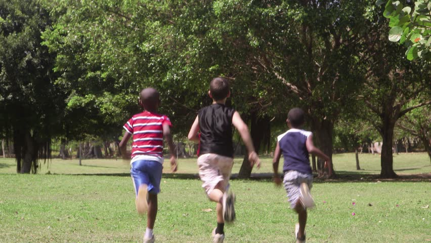 Children running and playing, group of male friends during recreation outdoor at summer camp - HD stock video clip