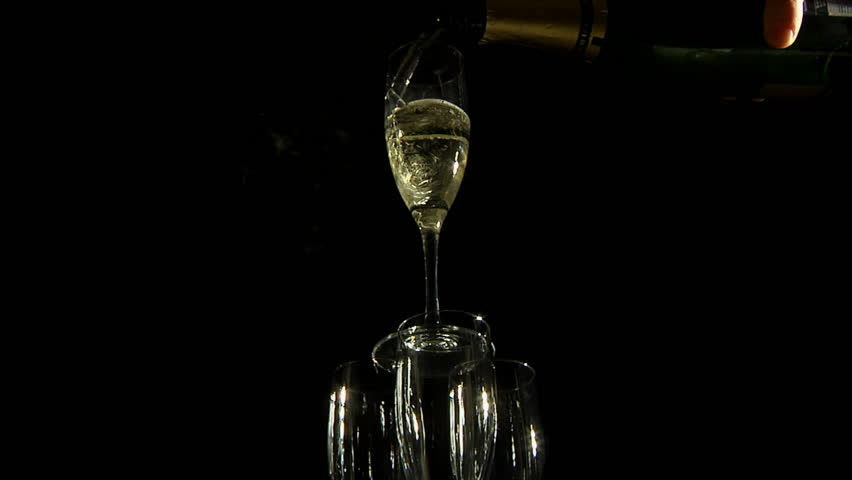 Champagne being poured into a glass pyramid