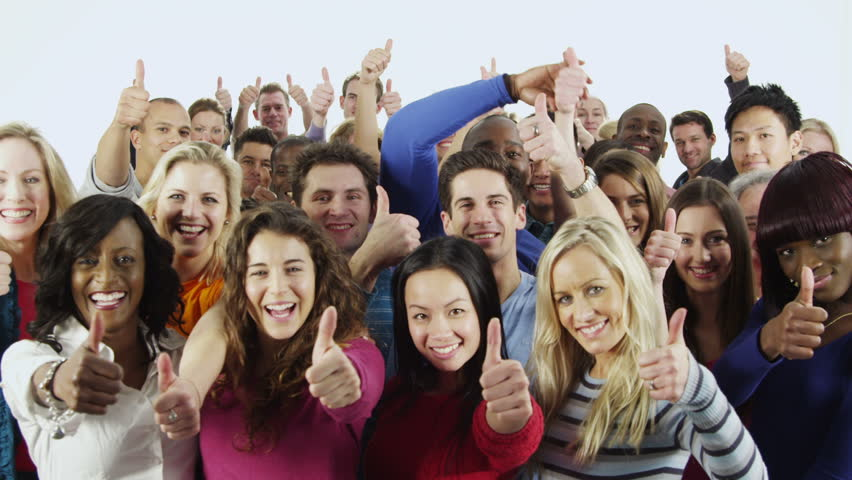 Portrait of a happy and diverse multi ethnic group of people in colorful casual clothing, isolated on white in a studio shot. They all hold their thumbs up to camera as a sign of their success. - HD stock footage clip