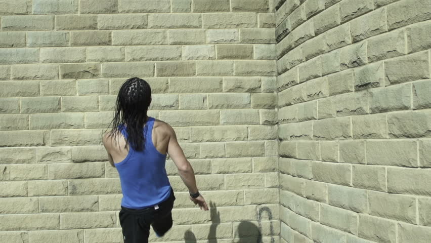 Backflip - A free runner back flips off a wall in super slow motion