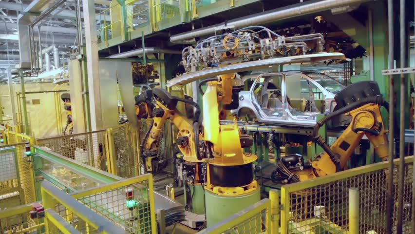 Robotics assemble automobile at conveyer in factory workshop