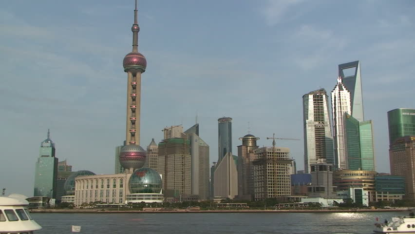 Passenger boat passing Shanghai's famous skyscrapers of Lujiazui district in