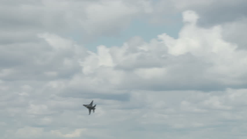 General Dynamics F-16 Fighting Falcon jet fighter flying.