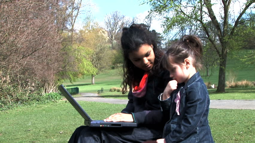 sisters on a laptop - HD stock video clip
