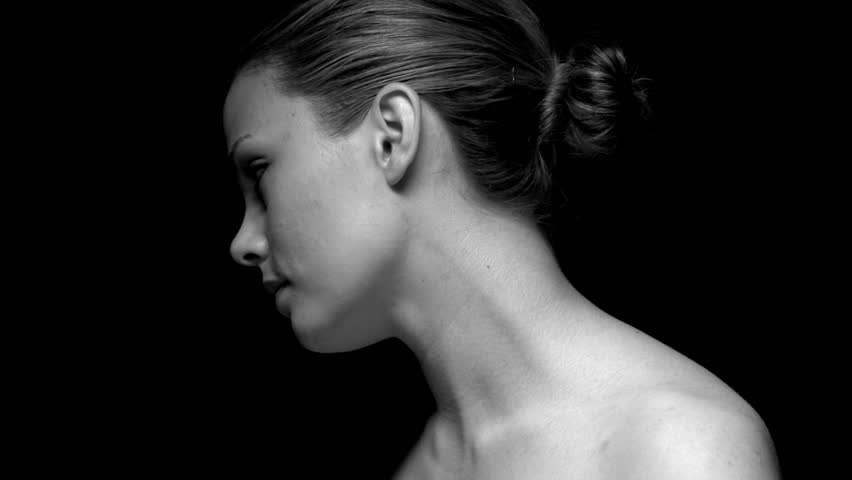 Woman facing away in black and white. Experimental lighting.