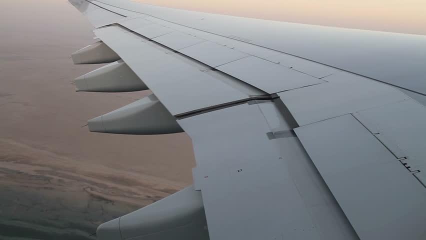 Aircraft wing,  flap and aileron moving while the flight - HD stock video clip