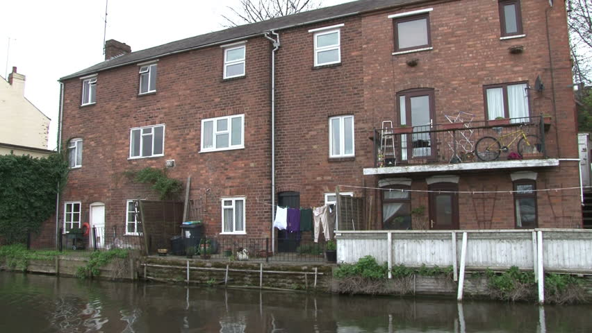 Terrace houses backing onto a canal. - HD stock footage clip