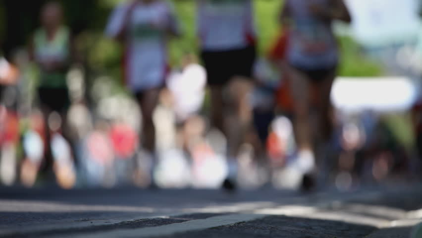 legs of marathon runners with shallow DOF - HD stock video clip