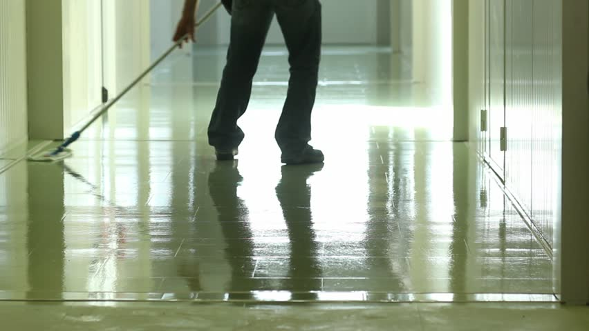A man cleaning and wipes the floor with a rag - HD stock footage clip